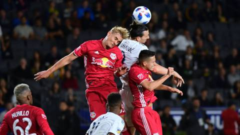 Zlatan Ibrahimovic of the LA Galaxy vies for the header with Aaron Long (L) and Florian Valot (R) of the New York Red Bulls in their MLS match in Carson, California on April 28, 2018. / AFP PHOTO / FREDERIC J. BROWN