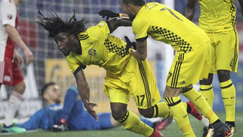 Columbus Crew midfielder Artur (7) celebrates a goal by defender Lalas Abubakar (17) during the second half of an MLS soccer game against the New England Revolution at Gillette Stadium in Foxborough, Mass, Saturday, May 19, 2018. (AP Photo/Stew Milne)